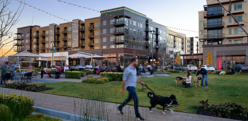 man walking dog in mixed-use development